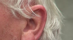 Man moves an ear 1 - stock footage