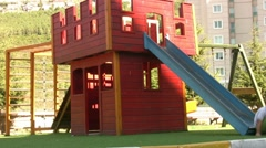 Little boy in playground Stock Footage