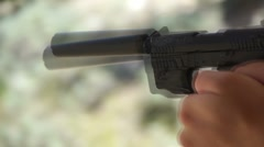 9mm pistol with suppressor Stock Footage