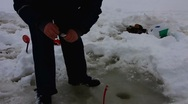 Stock Video Footage of Scandinavia Finland Reposaari ice fishing on frozen Baltic sea