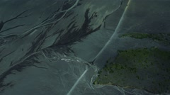 Aerial View of Vehicles Driving Past Flooded River Deltas, Iceland Stock Footage
