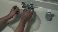 Man wash his hands using soft soap - stock footage