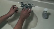 Man wash his hands using soft soap Stock Footage