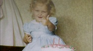 Stock Video Footage of Girl with Birthday Cake Circa 1950 (Vintage 8mm Home Movie Footage) 581