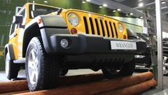 Motor show. Yellow jeep wrangler - stock footage