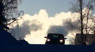 Scandinavia Finland car auto against smokestacks belches smoke steam in sky Stock Footage
