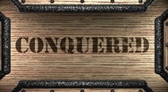 Stock Video Footage of conquered on wooden stamp
