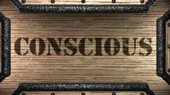 conscious on wooden stamp - stock footage