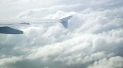 Clouds under a wing (window view) Stock Footage