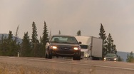Trucking, white truck on highway curve, long shot, sunset Stock Footage