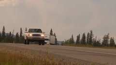 trucking, two trucks on curve - stock footage