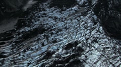 Stock Video Footage of Aerial View of Mountain Ridges & Ash Covered Glacier, Iceland