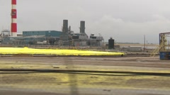 Drive plate, industrial sulfur plant, medium shot Stock Footage