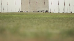 Stock Footage - Washington Monument - Tourists - low angle Day Stock Footage