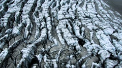 Aerial View of Ice Crevices with Black Volcanic Ash, Iceland - stock footage