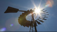 Windmill with sun flare Stock Footage
