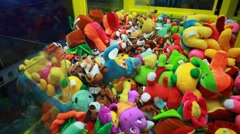 Attempt to win in slot machine for children with many stuffed toys Stock Footage