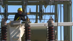 Electrical worker on substation zoom Stock Footage