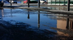 Scandinavia Finland car splashing melted water on road side Stock Footage
