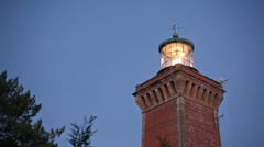 Lighthouse illuminated Stock Footage
