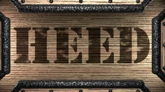 Heed on wooden stamp Stock Footage
