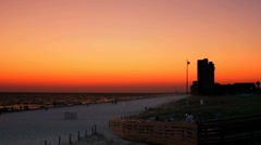 People on beach at sunset along the emerald coast in Panama City Beach, Fl - stock footage