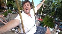 """Father """"Flying"""" on Swing Ride at Amusement park Stock Footage"""