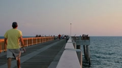 Stock Video Footage of People on Dan Russell Pier at sunset in Panama City Beach
