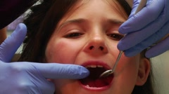 Little girl's face as dentist examines mouth Stock Footage
