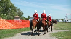 Canadian Mounties riding in park Stock Footage