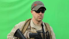 Soldier scanning the horizon on green screen (HD) C Stock Footage