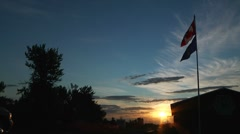 Canadian and Alberta Flags at Sunrise Stock Footage