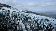 Stock Video Footage of Aerial View of Ice Crevices with Black Volcanic Ash, Iceland