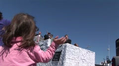 Little girl waving and catching beads at Mardi Gra parade Stock Footage