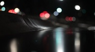 Stock Video Footage of Stock Footage - Traffic at night - Reflecting off a bench - Washington D.C