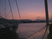 Sunset over boat railing Stock Footage