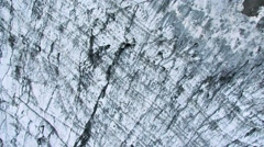 Aerial View of an Icelandic Glacier Encrusted with Volcanic Ash, Iceland Stock Footage