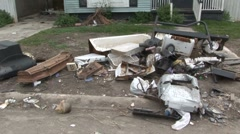 Katrina debris outside of house - stock footage