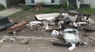 Stock Video Footage of Katrina debris outside of house