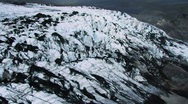 Stock Video Footage of Aerial View of Ice Glacier with Volcanic Ash, Iceland