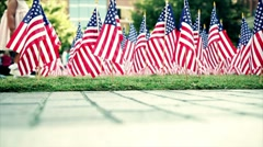 American flags with little girl walking Stock Footage