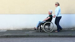 nurse with disabled senior woman - stock footage