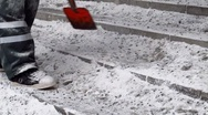 Stock Video Footage of Scandinavia Finland man shoveling scraping hitting frozen ice on steps