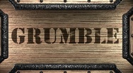 Grumble on wooden stamp Stock Footage