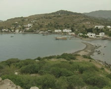 Zoom in to Gulet moored in bay Stock Footage