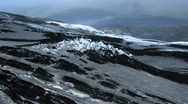 Stock Video Footage of Aerial View of Ice Formations Covered in Volcanic Ash, Iceland