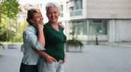 Two happy elderly women smiling Stock Footage