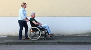 Nurse driving disabled woman Stock Footage