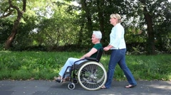 disabled senior woman in a park - stock footage