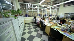 Few women work at tables in workplace at Estet Jewelry House manufacturing Stock Footage